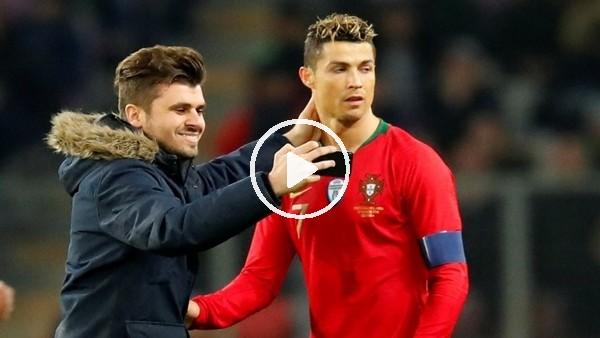 Çılgın tafaftar sahaya dalıp Cristiano Ronaldo'yu öptü ve selfie çekti